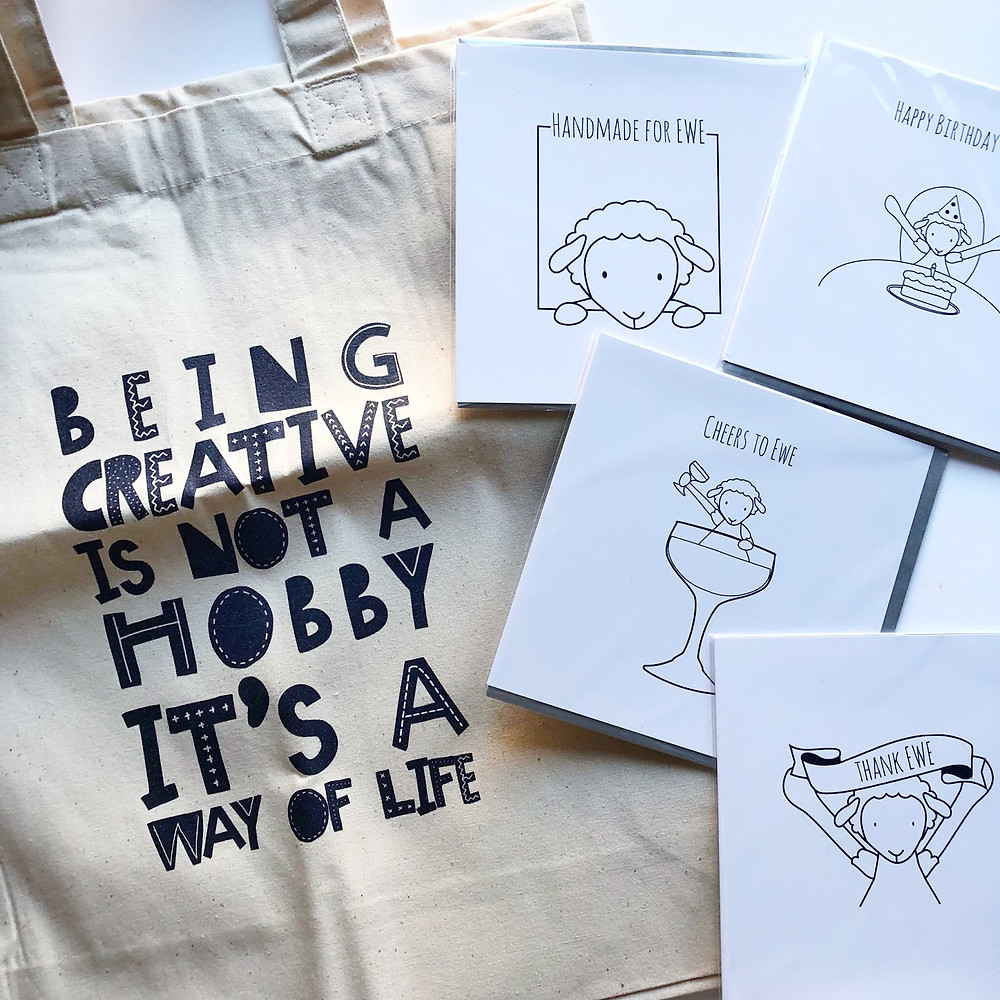 Collection of Dear Ewe products including tote bag and greetings cards