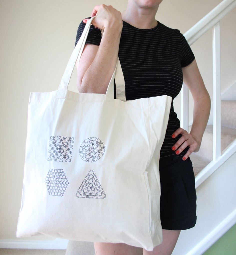 Rosina holding a Crochet Chart Tote bag