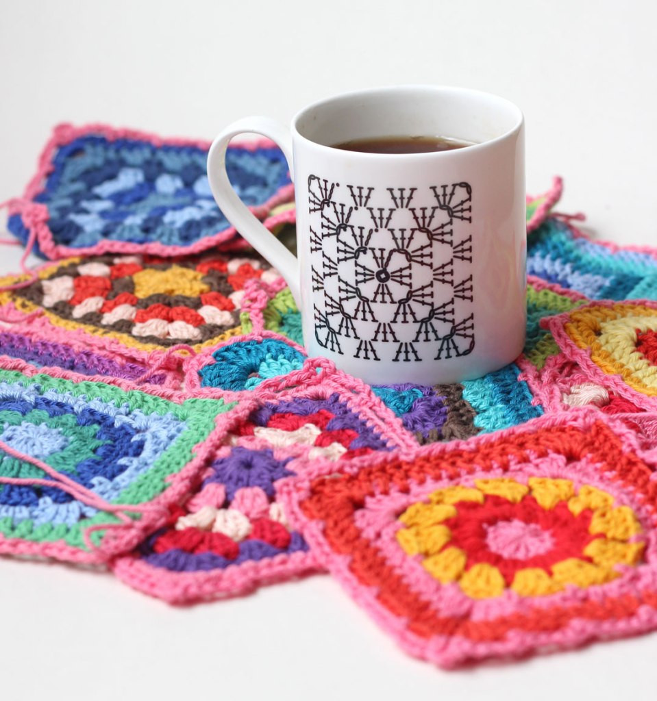 Dear Ewe granny square chart mug surrounded by bright and colourful granny squares