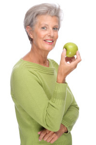 OlderWomanEatingApple
