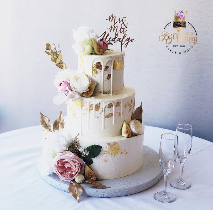 Semi naked cake with chocolate drip, gold leaf, fresh flowers and figs