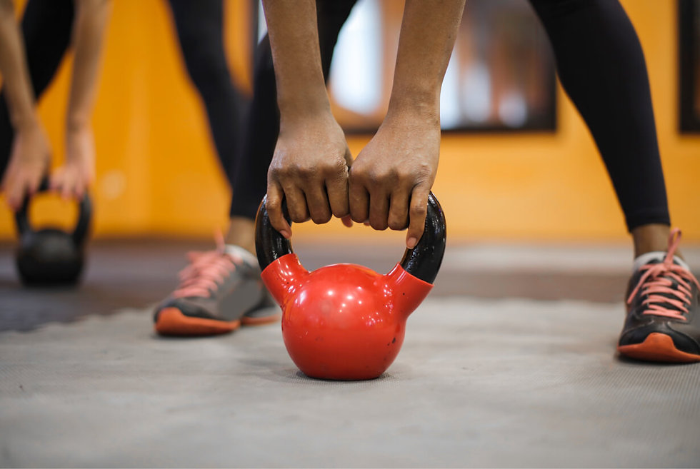Person holding kettlebell during an exercise class