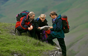 Hikers reading a map in the Lake District