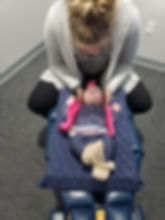 Dr. Jessica adjusting a young patient