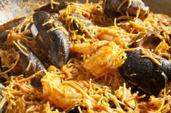 Spanish seafood and noodle stew: fideua.