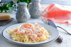 Italian pasta fettuccine in a creamy sau