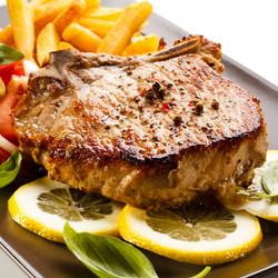 Fried pork chop, chips and vegetable sal