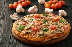 Homemade pizza with ham,mushrooms, tomat