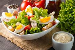 Fresh Caesar salad with delicious chicke