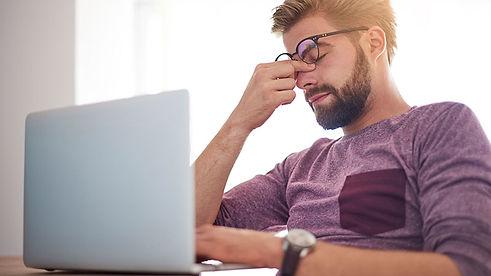 stressed_out_man_laptop_headache.jpg