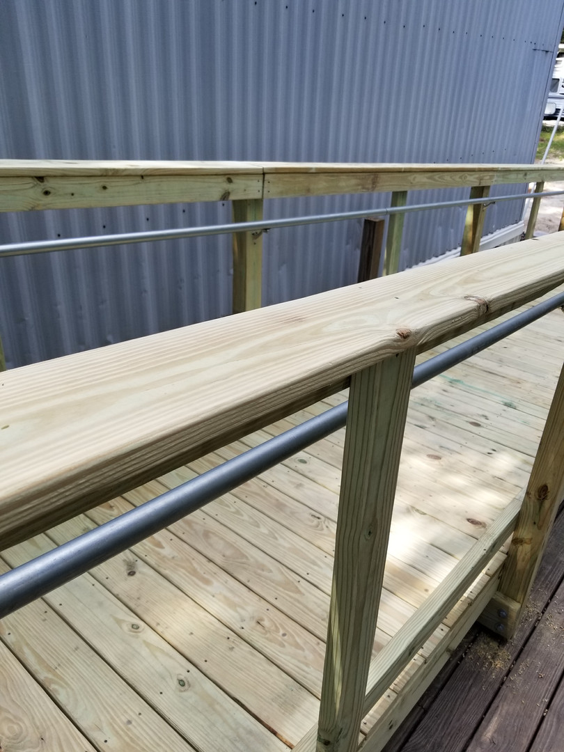 Wheelchair ramp with safety rails