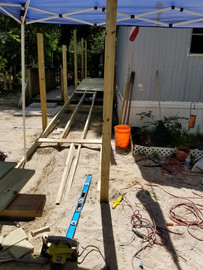 Wheelchair ramp being built to home accessibility.