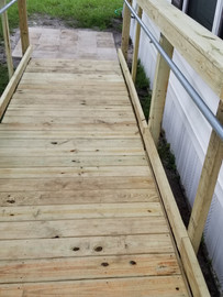 Wheelchair wood ramp with safety rails