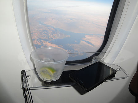 airplane window tray, phone, drink, view, glasses, airplane travel comfort, space