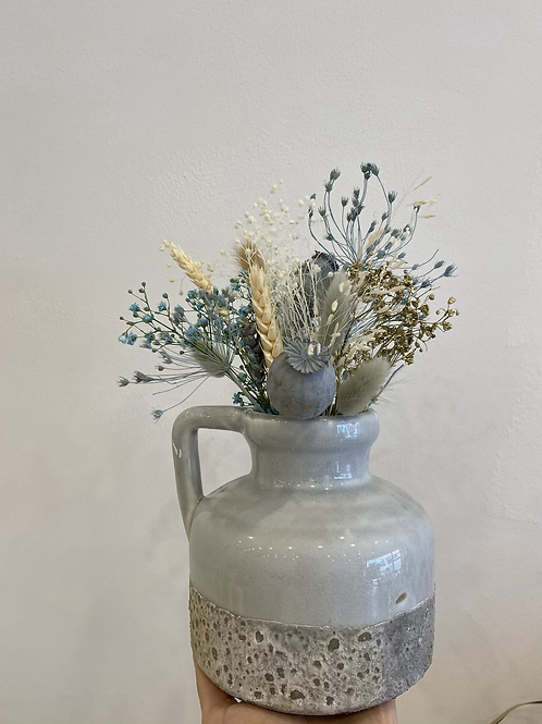 Vase with dried flowers