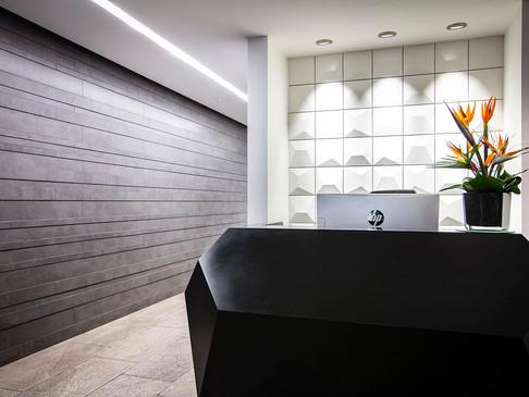 INVITE Compact Reception Desk finished in Deep Nocturne Corian®