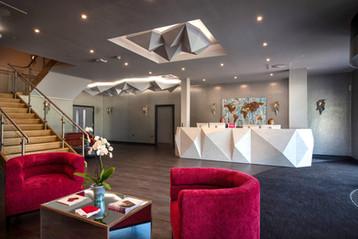 Corian faceted reception desk finished in Limestone Prima Corian®