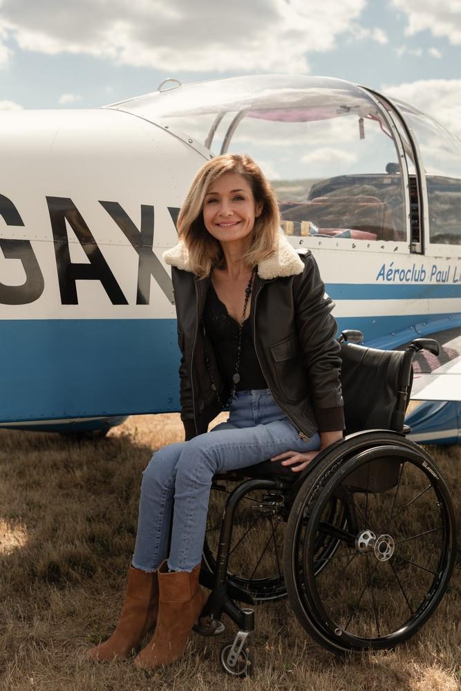 Dorine femme pilote fauteuil