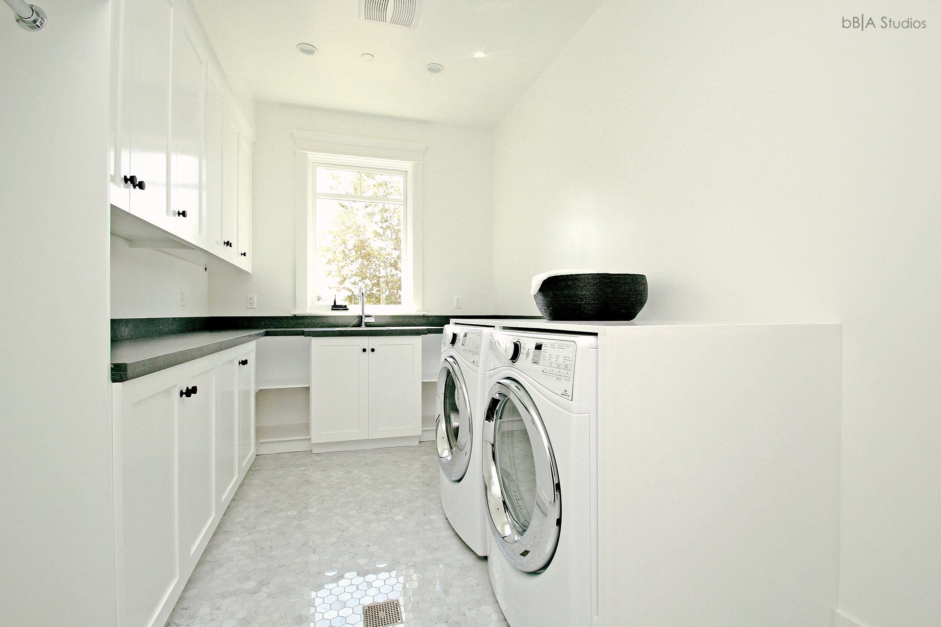 Laundry room in cape cod home