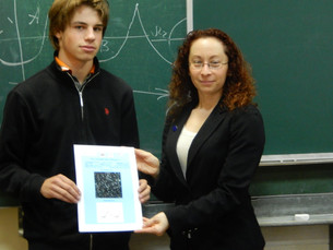 AAVSO Director Dr. Stella Kafka gives diplomas to the young discoverers of new variable stars
