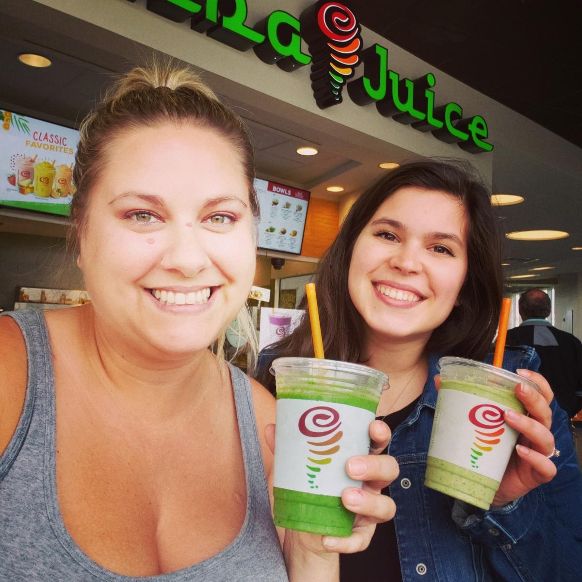 two girls drinking smoothies at jamba