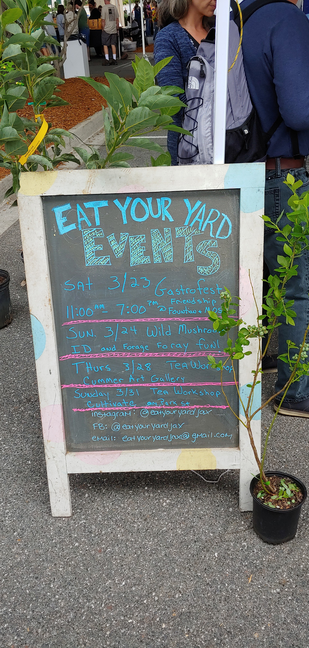 """A sign that says """"eat your yard events"""" at the Riverside Arts Market."""