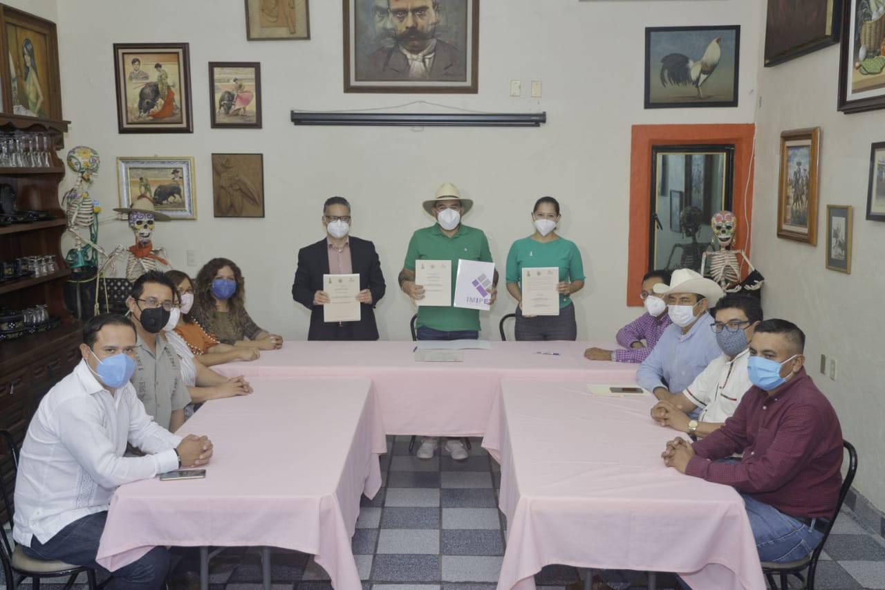 Firma de carta compromiso en transparencia con el IMIPE