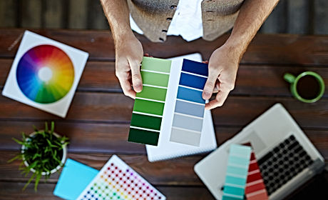 Color swatches in hands of interior-desi