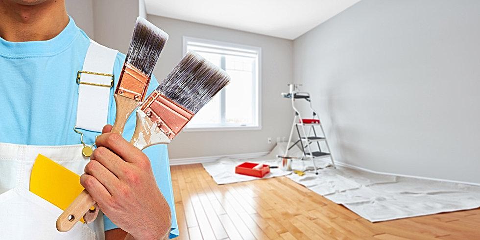 Painter hand with painting brush.jpg