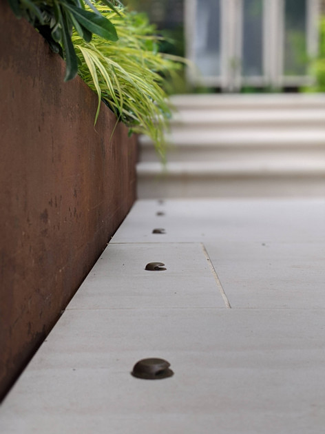 Taryn Ferris Garden Design - Detail- Corten Steel Retaining Wall and Recessed Copper Paving Lights - De Beauvoir Town