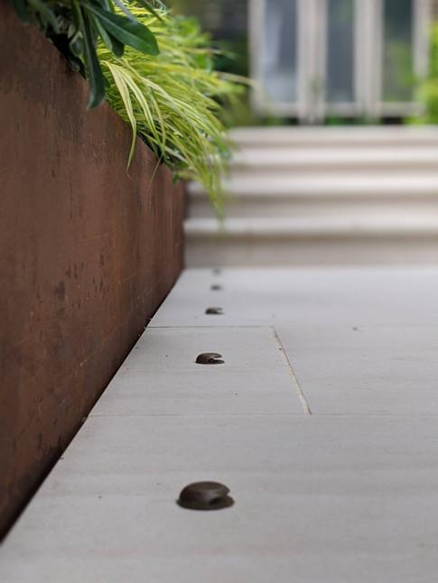 Taryn Ferris Garden Design - Detail- Corten Steel Retaining Wall and Recessed Copper Paving Lights - De Beauvoir Town