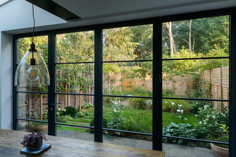 Taryn Ferris Garden Design - Wide View from Crittall-Style bi-fold Doors - Tuffnell Park family Garden