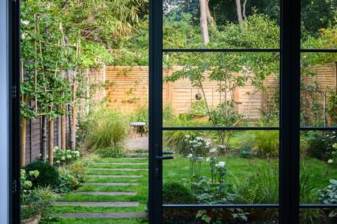 Taryn Ferris Garden Design - View from Crittall-Style bi-fold Doors - Tuffnell Park family Garden
