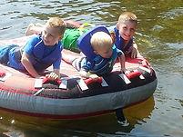 Boys tubing lake fun.jpg