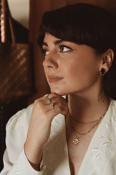 Alice Catherine is wearing our vintage gold jewellery. She wears out vintage rings and charm necklaces .
