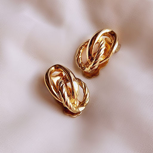 Vintage gold plated clip on earring swirls