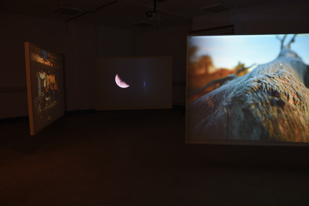Suspended triptych screen projection
