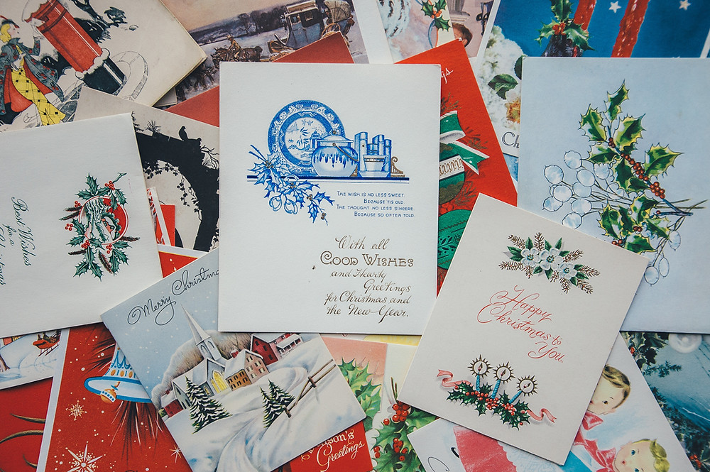 old-fashioned Christmas cards covering a table