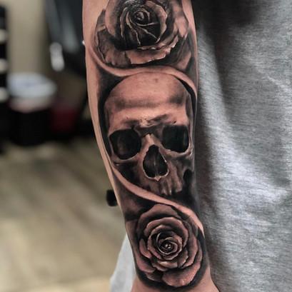 Skull and Roses Tattoo By Barnett Owner