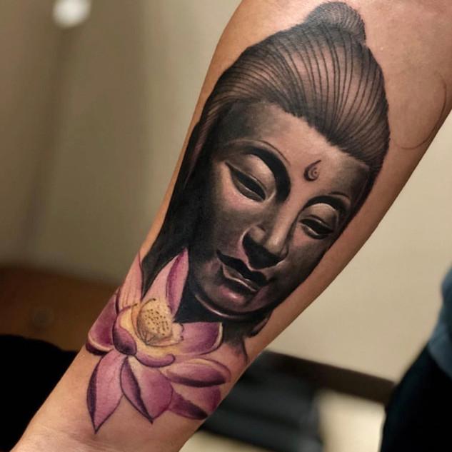 Buddah Head and Flower Tattoo By Barnett