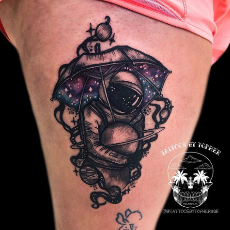 Spaceman and Galaxy Tattoo By Topher At