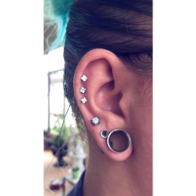 Triple Helix Piercing by Mousey at Fine