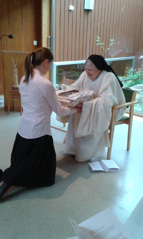 A Postulant receiving the Habit