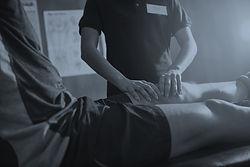 a physio massaging someone's leg