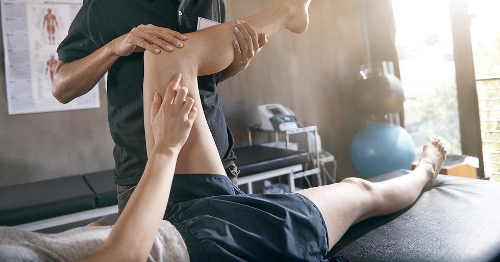 a physio assessing cycling injury