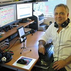 Eric Pollins seated in his audiobook recording studio
