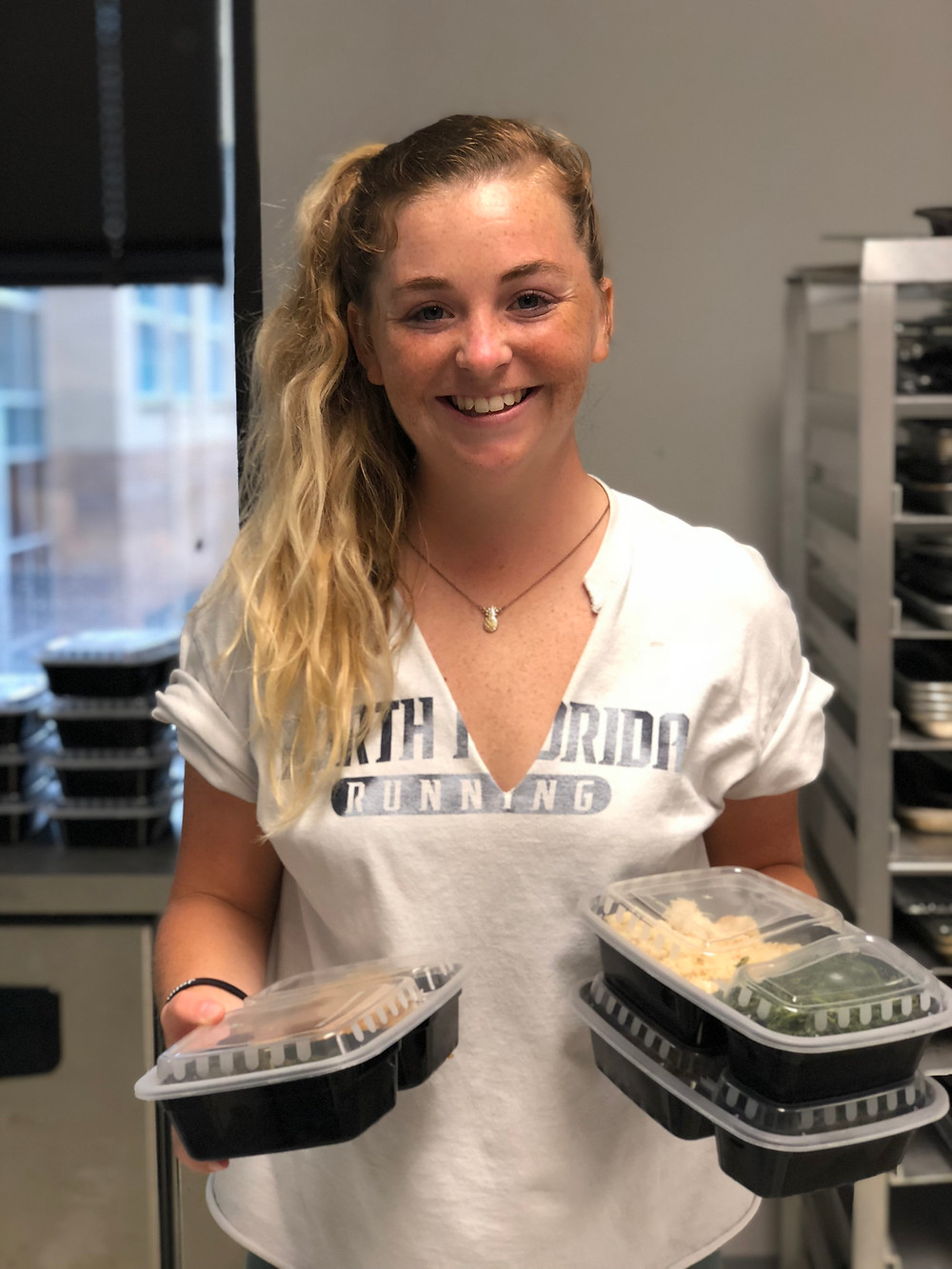 Aubrey Yost packaging food for Food Fighters.