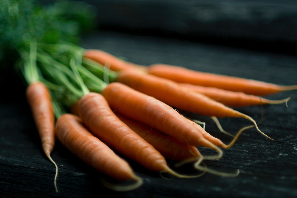 Carrots with their roots connected.