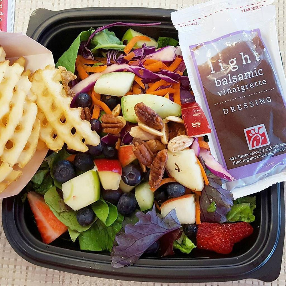 A Chick-Fil-A salad with fries and light balsamic vinaigrette.