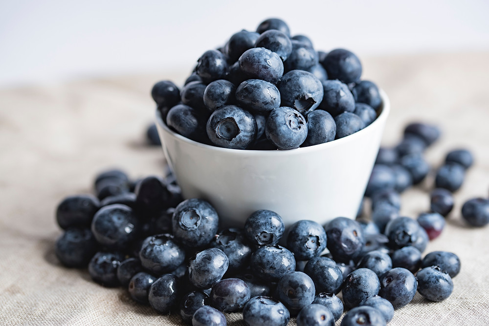 Blueberries in bowl and scattered around